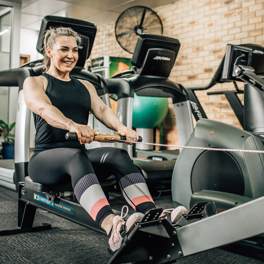 Fitness on the way trainer, Michelle on the rowing machine.